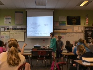 Students share their spacecraft design as part of an aerospace engineering lesson.